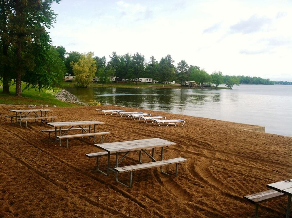 Beachfront with picnic tables.